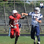Elyria Simeon Lawrence chases Valley Forge Brian Berry for an incomplete pass Sep. 21.  Steve Manheim