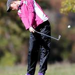 Avon's Kaitlin Neuman tees off on the third hole. (RON SCHWANE / CT)