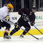 Eric Novakovic of Avon, right, moves puck away from Zach Moran of Lakewood in the GCHSHL All-Star game at Quicken Loans Arena on Mar. 7.   Steve Manheim
