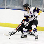 Avon's Braeden Friss takes control over a Normandy defender in the first period Sunday afternoon at Serpentini Arena. ANNA NORRIS/CHRONICLE