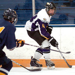 Avon's Pat Baeder tries to work the puck by Olmsted Falls' Zach Sadowski. LINDA MURPHY/CHRONICLE