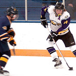 Avon's Alex Guzik works the puck past Olmsted Falls' Jacob Norman. LINDA MURPHY/CHRONICLE
