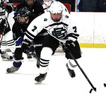 Elyria Catholc's Will Gentry chases down a loose puck in the first period. ANNA NORRIS/CHRONICLE