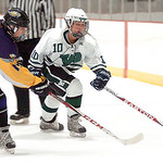 Avon's Jarret Greene and Westlake's Grace Jenkins reach for the puck. LINDA MURPHY/CHRONICLE