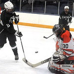 Westlake's Alex Miller takes a shot on North Olmsted goalie Chase Cullinan. STEVE MANHEIM/CHRONICLE