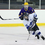 Midview's K.C. Kudela (16) gets a pass while pursued by Lakewood's Colin Scheel (7). photo by Ray Riedel