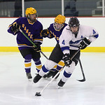 Midview's Bradley Urig moves the puck pursued by Lakewood's Nate Bonacuse (left) and Victor Dobos (behind). photo by Ray Riedel