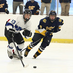 Midview's Manny Ceja (13) races Olmsted Falls' Hunter Bradford (7) for the puck. photo by Ray Riedel