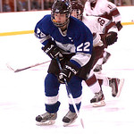 Midview's #22 Austin Steindle takes the puck down the ice past Rockey River's #16 Michael Ittu.