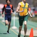 Scott Kelly, of Amherst, runs the 3rd leg of the Marion Steele 2nd place 4x800m relay team at the 2014 Comet Relays. photo by Ray Riedel