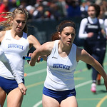 Brusnwick's #2 runner Gabby Maslowski hands off to Ashlely Danesi as their teams speeds to 1st place in the 4x100m relay at the 2014 Comet Relays. photo by Ray Riedel
