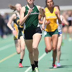 Medina's Sarah Pack leads the way in the third lap of the 1600m before finishing 2nd at the 2014 Comet Relays. photo by Ray Riedel
