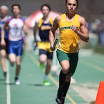 Michael Kardos, of Amherst, runs the 2nd leg of the Marion Steele 2nd place 4x800m relay team at the 2014 Comet Relays. photo by Ray Riedel