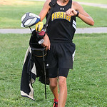 Tanner Hawley had a golf game and cross country meet one right after the other. photo by Ray Riedel