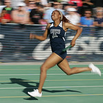 Lorain's Lamia Scott runs the anchor leg of their 2nd place 4×200 relay at the Division I Regional championships in Amherst. photo by Ray Riedel
