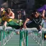 St. Ed's Steele Wasik (from Medina) bangs knees with Richard Floyd of Stronsville on the last hurdle of the 110m race. Floyd stumbled and Wasik passed him at the finish. Division I Regional  …