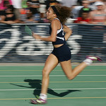Lorain's Destiny Wilson runs the 2nd leg of their 2nd place 4×200 relay at the Division I Regional championships in Amherst. photo by Ray Riedel
