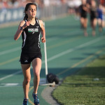 Medina Highland's Carlee Rhoads is all alone in the 3200m race after leading the entire way and coming close to the meet record at the Division I Regional championships in Amherst. photo by  …