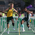 Richard Floyd of Strongsville stumbles after banging legs with Steele Wasik in the 110m hurdles as they fight for 1st place in the Division I Regional championships in Amherst. photo by Ray  …