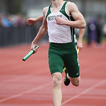 Westlake's Daniel Squeri crosses the finish in first place in the 4x400m relay at the Avon Relays. RAY RIEDEL/CHRONICLE