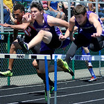 Vermilion's Brandon Cole jumps over the hurdles in the boys 100m against Orrville's Kevin Lyons and Triway's Mason Plant. KRISTIN BAUER | CHRONICLE