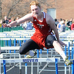 Rob Becker of Firelands competes in the boys 100 meter hurdles preliminary event. STEVE MANHEIM/CHRONICLE