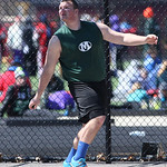 Medina's Mike Hierholzer watches the disk as he wins 1st place in discus throw at the Avon Lake Invitational Meet. photo by Ray Riedel