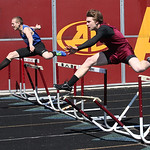 David Winkel hits a hurdle but places 2nd in the 300m hurdles at the Avon Lake Invitational Meet. photo by Ray Riedel
