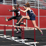 Lorain's Destiny Wilson is side by side with Avon Lake's Charlotte Ward in the 300m hurdles at the Avon Lake Invitational Meet. photo by Ray Riedel