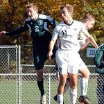 Amherst's No. 11 Mark Ferber heads the ball before Strongsville's No. 2 Jared Abston and Amherst's No. 6 Garrett Klekota.