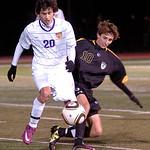 10-27-11 linda murphyAvon's #20 Ryan Repas works the ball past Amherst's #10 Bradley Mieden.