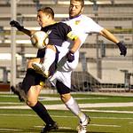 10-27-11 linda murphyAvon's #5 Kevin Manouchehri blocks and takes the ball from Amherst's #3 Connor Kiekota.
