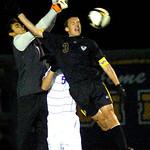 10-27-11 linda murphyAvon's goalee #1 Austin Saini blocks Amherst's #3 Connor Klekota's header.