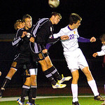 Avon Lake's No. 8 Nick Stephenson and Avon's No. 23 Ryan Poyle fight for a header.