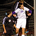 Avon Lake's No. 16 Jordan Arch heads the ball out of his goal as Avon's No. 23 Ryan Poyle tries to head it.