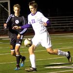 Avon's No. 23 Ryan Pyle tries to work the ball around Avon Lake's No. 16 Jordan Arch.