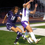 Avon's #14 Christina Petrillo keeps Magnificat's #18 Alyssa Baumbick from clearing the ball out of the corner.