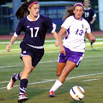 Magnificat's #17 Anne Ubbing fights Avon's #13 Maggie O'Donnell for the ball.
