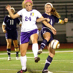 Avon's #24 Madison Sustar and Magnificat's #4 Clara Murray fight for the ball.