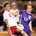 Avon's Holly Ohradzansky battles Wadsworth's Danielle Braman for the ball during their regional Semifinal game at Rocky River. Photo by Aaron Josefczyk
