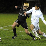 North Olmsted's Benjamin Gebura, left, and Westlake's Omar Salem chase after the ball. STEVE MANHEIM/CHRONICLE