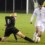 Westlake's Omar Salem, right, and North Olmsted's Benjamin Gebura go after the ball. STEVE MANHEIM/CHRONICLE