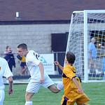 North Ridgeville's Daniel Knoblauch, left,  heads the ball away from Avon's Daniel Minotti. STEVE MANHEIM/CHRONICLE