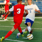 Midview's James Hughes and Elyria's Christian Negron battle for control of the ball. AMANDA K. RUNDLE/CHRONICLE