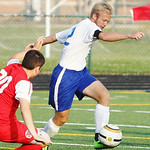 Midview's Nicolas Thomas defends a shot on goal by Elyria's Carlos Lopez. AMANDA K. RUNDLE/CHRONICLE