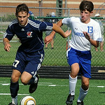 Oberlin's Jack McMillin moves the ball away from Midview's Noah Bartone. STEVE MANHEIM/CHRONICLE