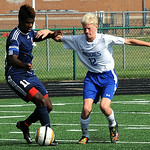 Oberlin's Amani Crowley, left, battles Midview's Tyler Thompson. STEVE MANHEIM/CHRONICLE