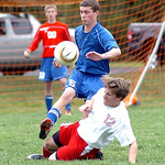 Open Door's Caleb Crowder kicks the ball away from First Baptist's Brett Snelling. LINDA MURPHY/CHRONICLE