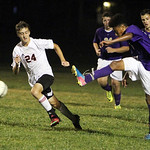 ANNA NORRIS/CHRONICLE Vermilion's Justin Delaney pushes the ball up the field away from Firelands' Jack O'Keefe late in the second half Monday night in South Amherst.