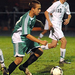 Columbia Nate Hite moves ball away from Columbia 10 Laszlo Szabados in Div. III district Oct. 23.   Steve Manheim